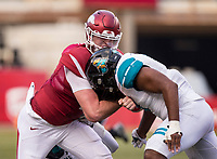 Hawgs Illustrated/BEN GOFF <br /> Cole Kelley, Arkansas quarterback, goes down in the backfield with Marcus Williamson (left), Coastal Carolina defensive end, and Shane Johnson, Coastal Carolina linebacker, on the tackle, in the second quarter Saturday, Nov. 4, 2017, at Reynolds Razorback Stadium in Fayetteville.