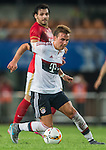 Mario Gotze of Bayern Munich being followed by Ricardo Goulart of Guangzhou Evergrandeduring the Bayern Munich vs Guangzhou Evergrande as part of the Bayern Munich Asian Tour 2015  at the Tianhe Sport Centre on 23 July 2015 in Guangzhou, China. Photo by Aitor Alcalde / Power Sport Images