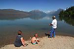 A family relaxes by Lake McDonald in Glacier National Park, Montana.