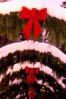 Butchart Gardens, Brentwood Bay near Victoria, Vancouver Island, BC, British Columbia, Canada - Red Christmas Bows on Snow Covered Coniferous Branches
