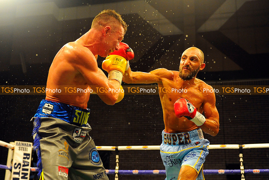Bradley Skeete (light blue shorts) defeats Shayne Singleton during a Boxing Show at the Brentwood Centre on 2nd June 2017