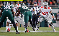 Ohio State Buckeyes offensive lineman Billy Price (54) and Ohio State Buckeyes offensive lineman Taylor Decker (68) against Michigan State Spartans at Spartan Stadium in East Lansing, Michigan on November 8, 2014.  (Dispatch photo by Kyle Robertson)