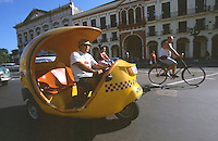 12 FEB 2003 - HAVANA, CUBA - One of Cubas cocotaxis searches for a fare (PHOTO (C) NIGEL FARROW)