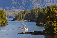 Commercial fishing vessel Finesse passes through the islands in Sitka Sound, southeast, Alaska.