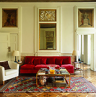 A striking 1950's red velvet sofa by Ignazio Gardello in the living room