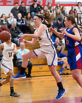 WINSTED,  CT-021919JS16-  Housatonic's Caroline Hurlburt (10) tries to save the ball from going out of bounds in front of Nonnewaug's Maddie Woodward (34) during their Berkshire League semi-final game Tuesday at Northwestern Regional High School in Winsted. <br /> Jim Shannon Republican American