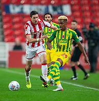 4th November 2019; Bet365 Stadium, Stoke, Staffordshire, England; English Championship Football, Stoke City versus West Bromwich Albion; Grady Diangana of West Bromwich Albion passes the ball in front of Stephen Ward of Stoke City - Strictly Editorial Use Only. No use with unauthorized audio, video, data, fixture lists, club/league logos or 'live' services. Online in-match use limited to 120 images, no video emulation. No use in betting, games or single club/league/player publications