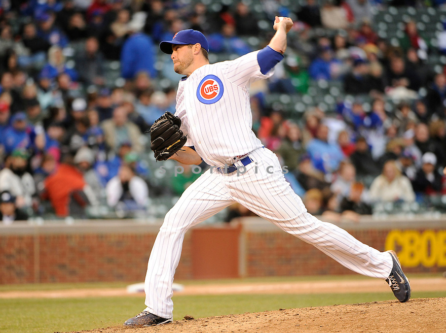 SEAN MARSHALL, of the Chicago Cubs , in actions during the Cubs game against the Arizona Diamondbacks at Wrigley FIeld on April 3, 2011.  The Cubs won the game beating the Diamondbacks 4-1.