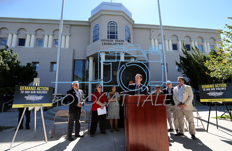 Nevada Sen. Justin Jones, D-Las Vegas, center, holds for a press conference in front of the Legislative Building in Carson City, Nev., on Tuesday, May 21, 2013. .Photo by Cathleen Allison