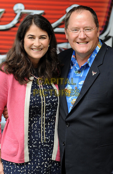 DENISE REAM (producer) & JOHN LASSETER (director).UK Premiere of 'Cars 2' at Whitehall Gardens, London, England..July 17th 2011.half length blue pink black print dress jacket suit shirt .CAP/WIZ.© Wizard/Capital Pictures.