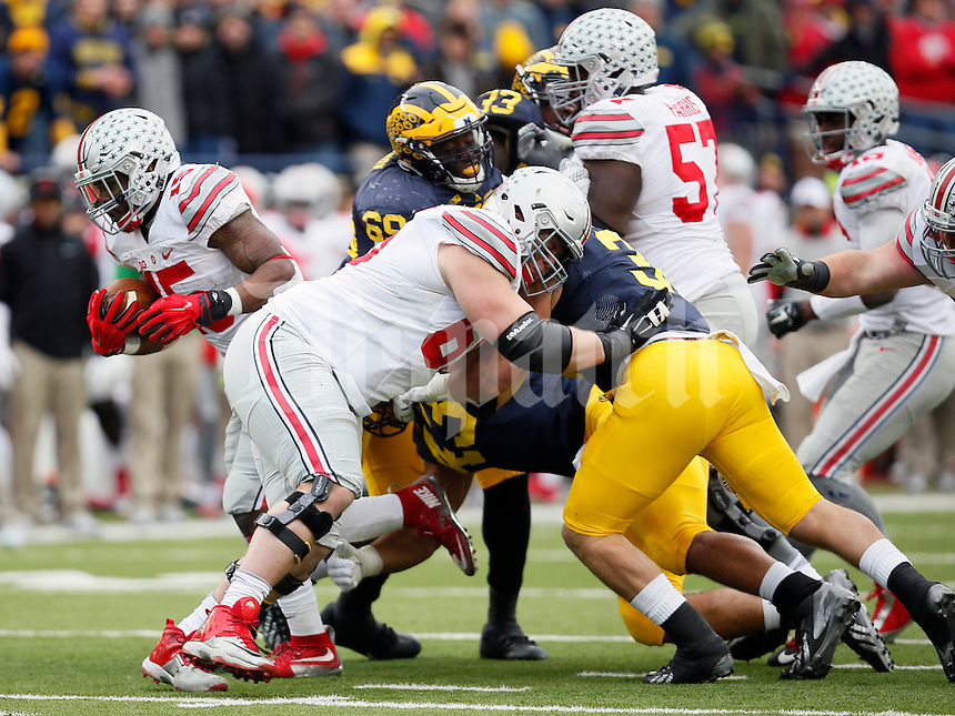 Ohio State Buckeyes offensive lineman Pat Elflein (65) against Michigan Wolverines at Michigan Stadium in Arbor, Michigan on November 28, 2015.  (Dispatch photo by Kyle Robertson)