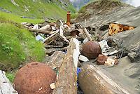 Trash and debris washed ashore at Kvalvika beach, Lofoten islands, Norway