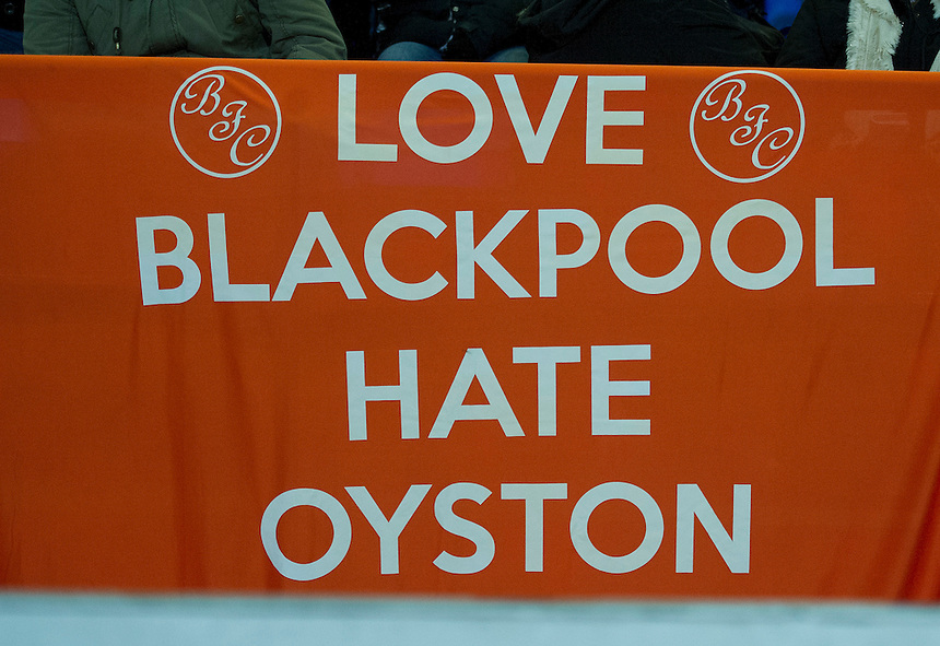 Blackpool fans display a banner during the match opposing club owner Owen John Oyston<br /> <br /> Photo by Stephen White/CameraSport<br /> <br /> Football - The Football League Sky Bet Championship - Bolton Wanderers v Blackpool - Tuesday 25th March 2014 - The Reebok Stadium - Bolton<br /> <br /> &copy; CameraSport - 43 Linden Ave. Countesthorpe. Leicester. England. LE8 5PG - Tel: +44 (0) 116 277 4147 - admin@camerasport.com - www.camerasport.com