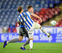 Lincoln City's Cian Bolger vies for possession with Huddersfield Town's Jon Gorenc Stankovic<br /> <br /> Photographer Chris Vaughan/CameraSport<br /> <br /> The Carabao Cup First Round - Huddersfield Town v Lincoln City - Tuesday 13th August 2019 - John Smith's Stadium - Huddersfield<br />  <br /> World Copyright © 2019 CameraSport. All rights reserved. 43 Linden Ave. Countesthorpe. Leicester. England. LE8 5PG - Tel: +44 (0) 116 277 4147 - admin@camerasport.com - www.camerasport.com