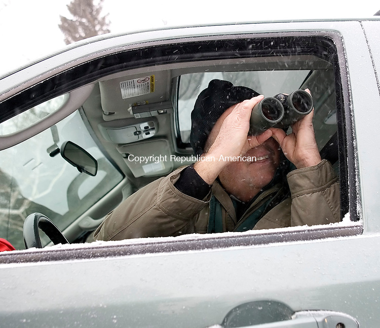 Goshen, CT-03, January 2010-010310CM07 --  Ray Belding of Torrington, spots junco birds in Goshen Sunday morning.  The frigid weather forced Belding to search for the birds from his vehicle. The study was part of the annual Christmas bird count from the Sharon Audubon Society in Falls Village.  Christopher Massa Republican-American