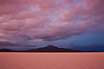 Salar de Uyuni at dramatic sunset; largest salt pan on earth; Altiplano, Bolivia