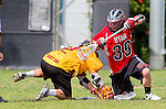 Los Angeles, CA 02/15/14 - Jake Berkelbach (Utah #39) and Jordan Shuchmann (USC #10) in action during the Utah versus USC game as part of the 2014 Pac-12 Shootout at UCLA.  Utah defeated USC 10-9.