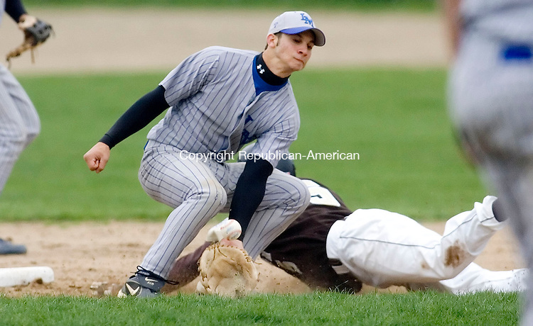 THOMASTON, CT- 12 MAY 2008- 051208JT06-<br /> Thomaston's Keith April slides safely into second as Lewis Mills' Kevin Nestico misses the ball during Monday's game. The Bears won 9-6.<br /> Josalee Thrift / Republican-American