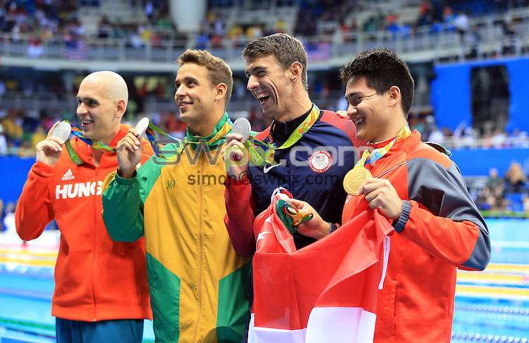 RIO DE JANEIRO, BRAZIL - AUGUST 12:  Laszlo Cseh of Hungary, Chad le Clos of South Africa and Michael Phelps of the USA win joint Silver and Joseph Schooling (R) of Singapore wins Gold in the Men's 100m Butterfly Final on Day 7 of the Rio 2016 Olympic Games at the Olympic Aquatics Stadium on August 12, 2016 in Rio de Janerio, Brazil.  (Photo by Vaughn Ridley/SWpix.com)