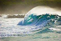 A Beautiful large wave barrels in the powerful shorebreak at Waimea Bay, on the North Shore of Oahu.