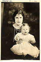 BNPS.co.uk (01202 558833)<br /> Pic: MarcusAdams/ChiswickAuctions/BNPS<br /> <br /> Princess Elizabeth(8 mths) with her mother in January 1927.<br /> <br /> Charming childhood photos of Princess Elizabeth and Princess Margaret have come to light, including a previously unseen image of the future Queen in a kilt.<br /> <br /> The portraits, taken by acclaimed British society photographer Marcus Adams, capture the future Queen from being a baby to her adolescence.<br /> <br /> The Queen Mother would often take her daughters to his central London studio where he would set up toys and props to keep them entertained