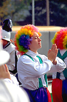 High school clown cheerleaders age 17 performing at football game. Augsburg College Minneapolis  Minnesota USA