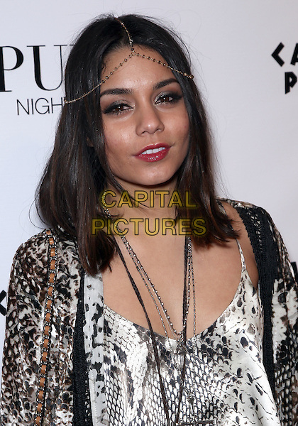 "VANESSA HUDGENS.celebrates the release of her new film ""Sucker Punch"" at Pure Nightclub inside Caesar's Palace Resort Hotel and Casino, Las Vegas, Nevada, USA, .26th March 2011..portrait headshot make-up red lipstick necklace silver  snakeskin snake print white  black tassels fringed cardigan jacket  bag hair head chain .CAP/ADM/MJT.© MJT/AdMedia/Capital Pictures."