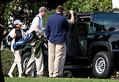 Washington, DC - October 25, 2009 -- Melody Barnes, left, domestic policy adviser, walks to the vehicle carrying U.S. President Barack Obama before departing to play golf from the White House in Washington, D.C., U.S., Sunday, October 25, 2009. .Credit: Joshua Roberts / Pool via CNP
