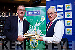 Kerry County Committee Chairman Tim Murphy presents Maurice Leahy with the Sliotar and Hurley to mark his retirement as a GDA with the Kerry County Committee for the past 37 years at the Stretford End in Causeway on Saturday last.