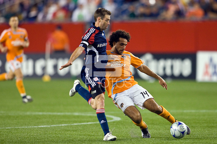 Houston Dynamo forward Dwayne De Rosario (14) is marked by New England Revolution midfielder Steve Ralston (14). The New England Revolution defeated the Houston Dynamo 2-2 (6-5) in penalty kicks in the SuperLiga finals at Gillette Stadium in Foxborough, MA, on August 5, 2008.
