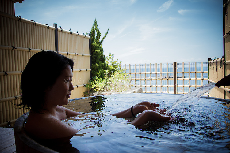 Izu peninsula, July 2012 - Japanese girl having a bath outside (rotemburo) in Toi.