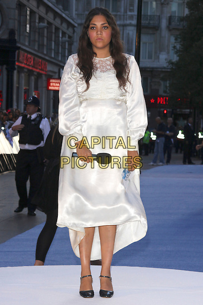 "MIQUITA OLIVER .At ""The Life And Death Of Charlie St. Cloud"" UK film premiere, Empire cinema, Leicester Square, London, England, UK, 16th September 2010. .full length microphone white satin silk cream long sleeve dress mid heels ankle strap shoes.CAP/AH.©Adam Houghton/Capital Pictures."