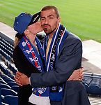 Sergio Porrini signs for Rangers and gets a smacker from wife Barbara