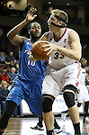 SIOUX FALLS, SD: DECEMBER 13: Justin Hamilton #33 from the Sioux Falls Skyforce backs down Rodney Bartholomew #10 from the Tulsa 66ers in the first half of their game Friday night at the Sanford Pentagon. (photo by Dave Eggen/Inertia)