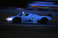 LE MANS, FRANCE - JUNE 11: The race-winning Sauber-Mercedes C9/88 88-C9-03 of Jochen Mass, Manuel Reuter and Stanley Dickens is driven at dusk during the 24 Hours of Le Mans at the Circuit de la Sarthe in Le Mans, France, on June 11, 1989.