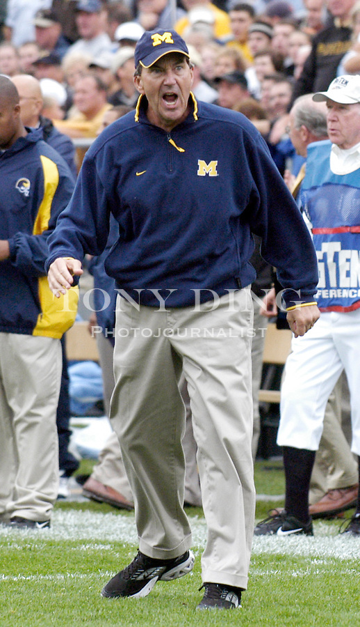 Michigan head coach Lloyd Carr is very upset that freshman running back Michael Hart's first quarter touchdown was being disputed during the Wolverines' 16-14 victory over the Purdue Boilermakers on Saturday, October 23, 2004 in at Ross-Ade Stadium in West Lafayette, Ind. (TONY DING/Daily).
