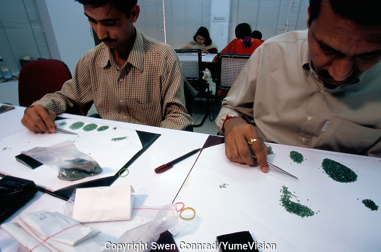 In Jaipur India, the world capital leader of Emerald cutter, those men's and woman's are in charge of selecting by size and quality of colour the stone