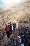 School students explore village path on trek in Atlas Mountains, Morocco