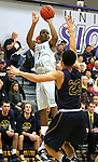 SIOUX FALLS, SD - JANUARY 2:  Kebu Johnson #4 from the University of Sioux Falls shoots a jumper over Jordan Spencer #23 from Augustana in the first half of their game Friday night at the Stewart Center. (Photo by Dave Eggen/Inertia)