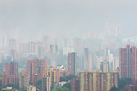 High rise luxury apartment buildings of El Poblado neighborhood, where the webcam models industry is concentrated, are seen rolling on the hills during a misty morning in Medellín, Colombia, 28 February 2016. With the traditional adoration of female beauty in Colombia, together with rapidly developing telecommunications technologies, the millennial generations of Colombian girls have turned the city of Medellín during the past few years into a one of the world centers of webcam modelling, a booming interractive sex industry. Thousands of young women stream everyday via websites that allow the global viewers to personally interract with a model and to pay them for sexually related acts. Although the core of the show is always based on stripping, the crucial part of a cam girl's success is communication. Cam models who have the ability of light conversation, flirting and entertaining the viewer earn thousands of dollars a month and have moved far beyond the borders of sexuality. Sharing their whole lives in a constant interaction with their online clients, they have built regular relationships in the cyberspace.