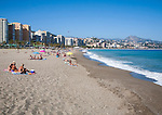 Playa de Malaguera sandy beach people sunbathing by the sea, Malaga, Spain