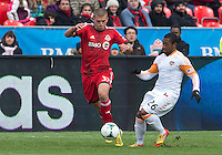 20 April 2013: Toronto FC midfielder Ryan Richter #33 and Houston Dynamo midfielder Corey Ashe #26 in action during an MLS game between the Houston Dynamo and Toronto FC at BMO Field in Toronto, Ontario Canada..The game ended in a 1-1 draw...