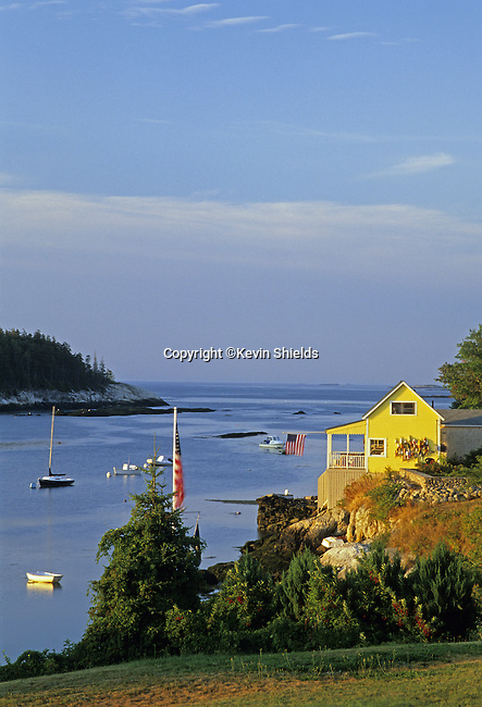 View of harbor at Five Islands, Georgetown, Maine, USA, showing boats, island and the Atlantic Ocean.