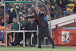 19 JUN 2010: Cameroon head coach Paul Le Guen (FRA) (standing). The Denmark National Team defeated the Cameroon National Team 2-1 at Loftus Versfeld Stadium in Tshwane/Pretoria, South Africa in a 2010 FIFA World Cup Group E match.