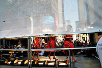 NEW YORK - MARCH 30: Three ladies walk off-stage after performing to promote Hershey's Chocolate in Times Square March 30, 2004 in New York City. Promotional events happen almost every day in Times Square, as there are always hundreds of pedestrians and tourists passing through. The New Times Square is the corporate Times Square. More than 200,000 people work here, and the big corporations (Time Warner, Disney, Viacom) have replaced the sex shops of the 70s and 80s. Here, performers promote Hershey's Chocolate. Times Square's 100th birthday is April 8, 2004. On April 8, 1904, Mayor George McClellan signed a resolution changing the name of Long Acre Square to Times Square. Times Square, a living icon of popular culture, is one of the most familiar and most frequently reproduced fragments of urban real estate on the planet. (Photo by Landon Nordeman, 2004)