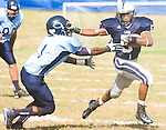 The Gazette Largo's Thomas Dixon holds Central defender Mark Davis at arm's length as he sprints for yards during the first half of Largo's homecoming game on Saturday afternoon at Largo.