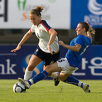 USWNT forward (8) Lauren Cheney is tackled by Italy's (5) Viviana Schiavi during the last group stage game at the Peace Queen Cup.  The USWNT defeated Italy, 2-0, at the Suwon Sports Center in Suwon, South Korea.