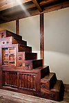 Tokyo, June 28 2013 - Tradittional staircase cabinet in the West Hall of Japan Folk Crafts Museum, former house of Japanese designer Soetsu Yanagi.