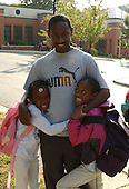 Kensington, MD - October 23, 2002 -- Everale Brumley holds his daughters Danelle, 7, right, and Moeine, 5, left after he picked them up from Oakland Terrace Elementary School in Kensington, MD on 23 October, 2002<br /> Credit: Ron Sachs / CNP<br /> (RESTRICTION: NO New York or New Jersey Newspapers or newspapers within a 75 mile radius of New York City)