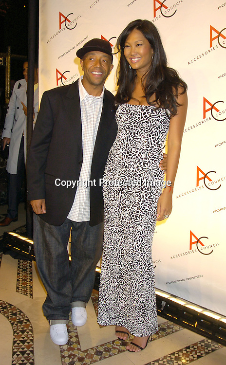 Russell Simmons and wife Kimora Lee Simmons ..at The Accessories Council 8th Annual ACE Awards on ..November 1, 2004 at Cipriani 42nd Street. ..Photo by Robin Platzer, Twin Images